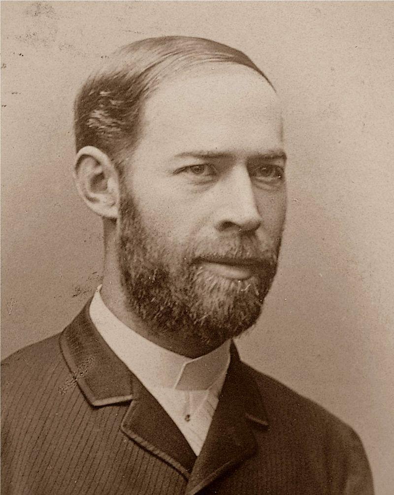 """Dem deutschen Physiker Heinrich Rudolf Hertz gelingt es 1882 elektromagnetische Wellen zu erzeugen. Mit deren Übertragung von einem Schwingkreis auf einen anderen wurde damit der Funksender geboren. """"Hertz"""" gilt seitdem als Einheit für Frequenz."""
